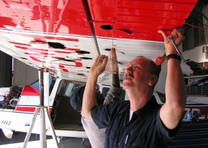 As a freelance aviation & space writer I've helped technicians like these men install an aircraft wing