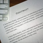 Paper contract next to keyboard