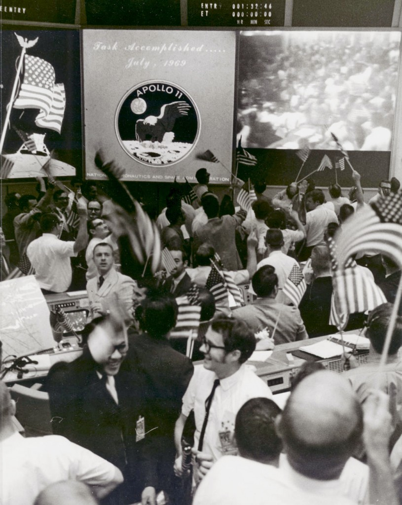 NASA mission controllers celebrate