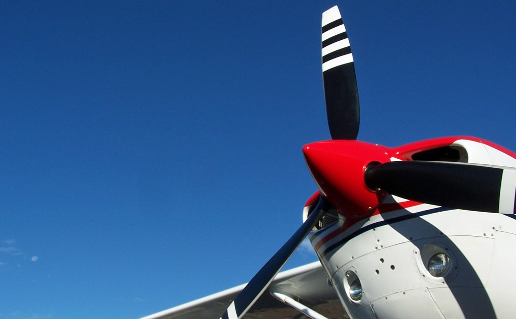 James Rush Manley - Aviation & Space Writer shows this Cessna 206 propeller against clear blue sky