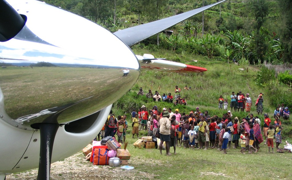 stopped aircraft propeller frames group of jungle residents