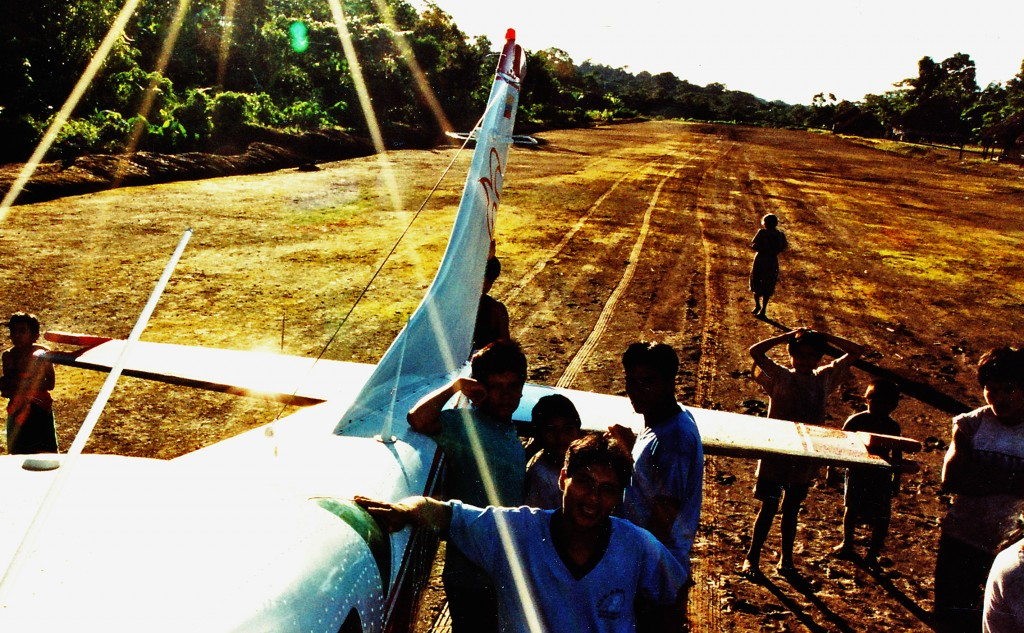 Airplane at jungle airstrip