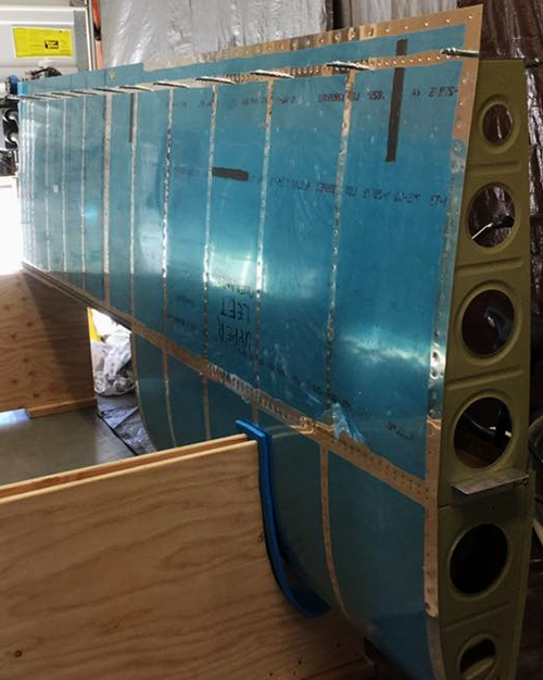 James Rush Manley - Aviation & Space Writer views the wing with most clecos replaced by rivets