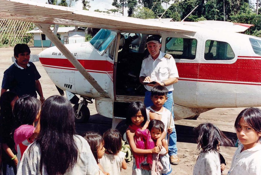 Jungle village kids and pilot at airplane