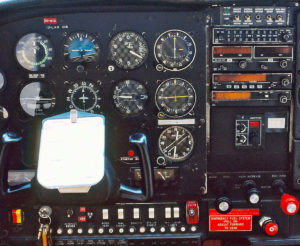 C-185 panel showing a six-pack in front and King Silver Crown radios.