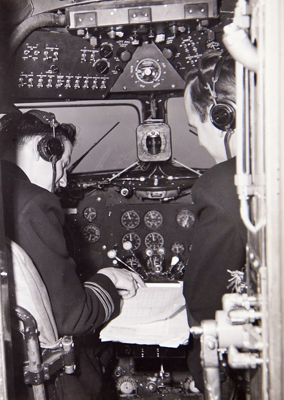 Two pilots in 1940s cockpit
