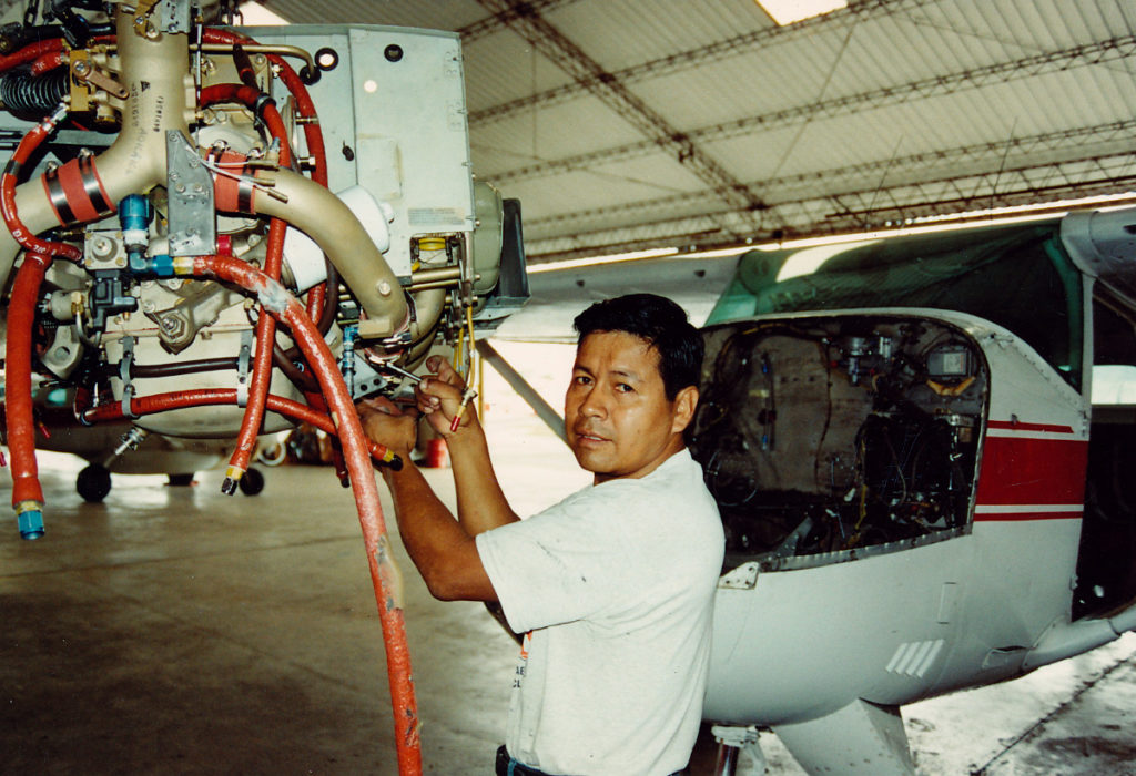 Mateo, a Lowland Quichua, prepares to install a new engine in a C-206.