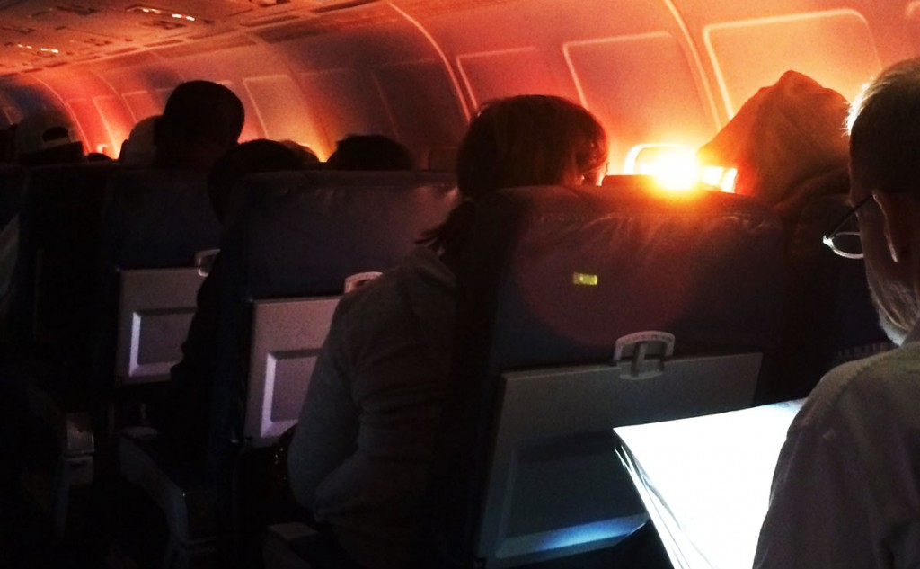 dawn light shines into airliner cabin