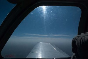 Looking over right wing of aircraft in flight