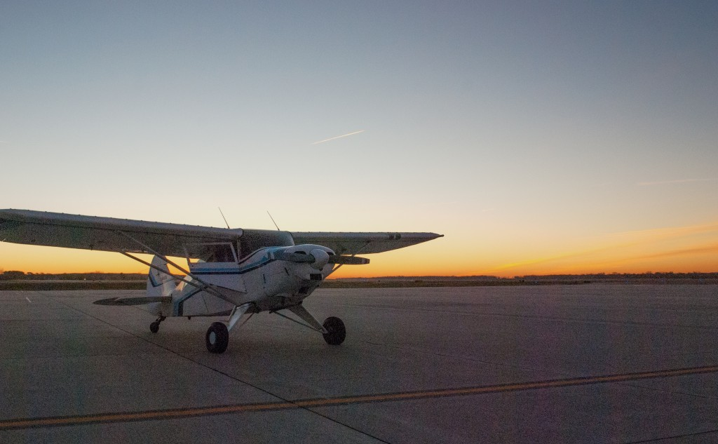 Piper Pacer on airport ramp at dawn