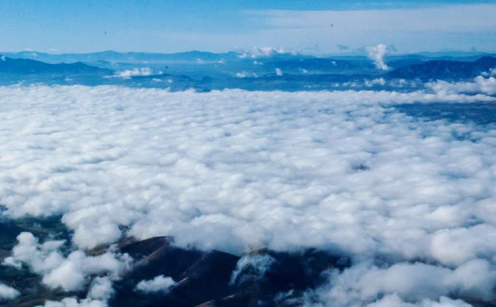 Aerial view of low clouds filling a valley