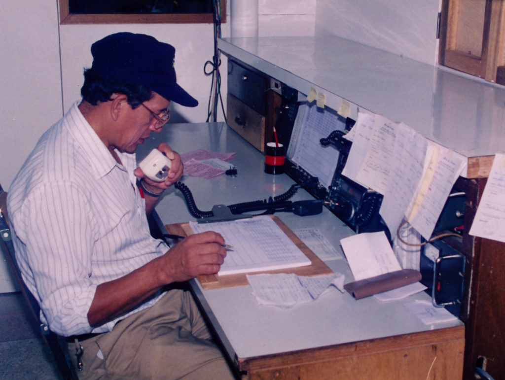 Lucas working as a dispatcher, using the radio to confirm our aircrafts' positions and status.