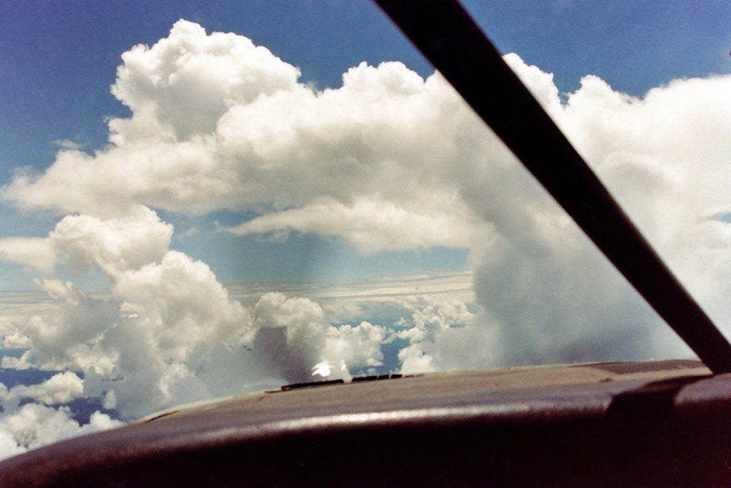 "Flying through clouds over the ""baranco"" (cliff) while returning to Shell from the jungle."