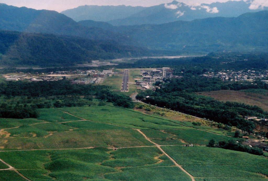 On final approach for runway 30 at Shell. The Pastaza river enters the Baños Pass.