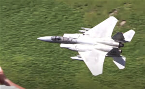a cool F-15C jet aircraft flying low