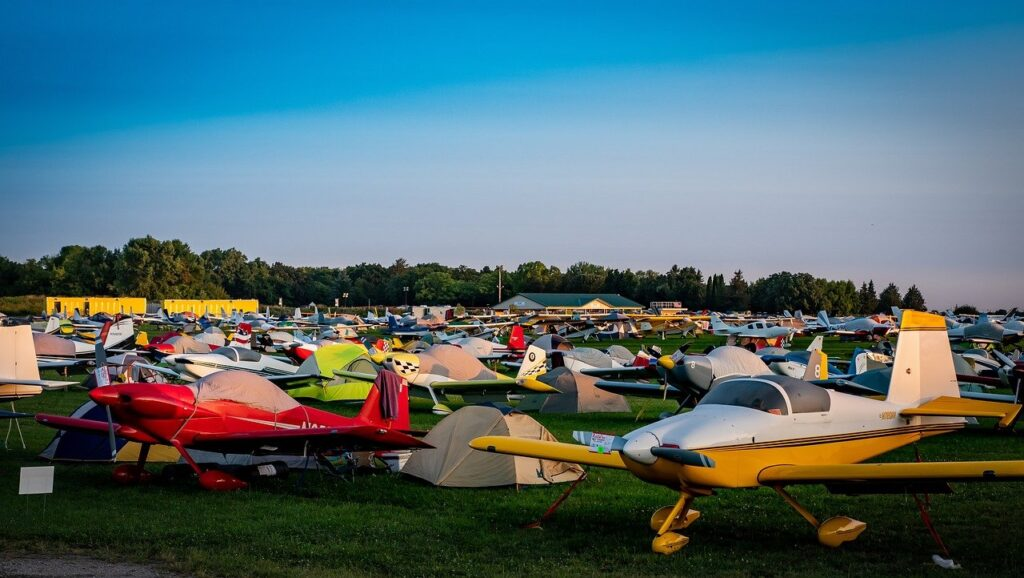 Visable heart displayed by many private aircraft parked on grass field