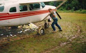 pilot pushing plane through mud needs grace